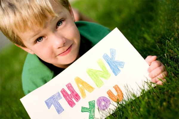 child-with-thank-you-sign